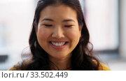 Купить «portrait of happy smiling asian young woman», видеоролик № 33502449, снято 26 марта 2020 г. (c) Syda Productions / Фотобанк Лори