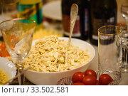 Купить «Салат из кальмаров стоит на праздничном столе», эксклюзивное фото № 33502581, снято 31 декабря 2019 г. (c) Игорь Низов / Фотобанк Лори