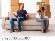 Купить «Young pair and many boxes in divorce settlement concept», фото № 33506397, снято 3 сентября 2019 г. (c) Elnur / Фотобанк Лори