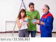 Купить «Young couple and old contractor in home renovation concept», фото № 33506861, снято 2 сентября 2019 г. (c) Elnur / Фотобанк Лори