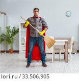 Купить «Super hero cleaner working at home», фото № 33506905, снято 22 декабря 2016 г. (c) Elnur / Фотобанк Лори