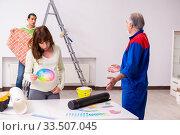 Купить «Young couple and old contractor in home renovation concept», фото № 33507045, снято 2 сентября 2019 г. (c) Elnur / Фотобанк Лори