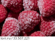 Купить «Appetizing background: freshly frozen raspberries with ice crystals macro», фото № 33507221, снято 7 апреля 2020 г. (c) ok_fotoday / Фотобанк Лори