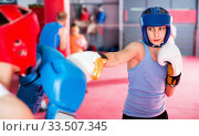 Купить «Two young boxer wearing gloves and helmet sparring», фото № 33507345, снято 12 апреля 2017 г. (c) Яков Филимонов / Фотобанк Лори