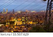 Купить «Illuminated Barcelona with high-voltage tower on foreground», фото № 33507629, снято 31 августа 2017 г. (c) Яков Филимонов / Фотобанк Лори