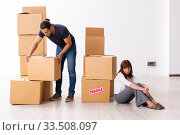Купить «Young pair and many boxes in divorce settlement concept», фото № 33508097, снято 3 сентября 2019 г. (c) Elnur / Фотобанк Лори