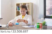 Купить «girl with test tubes studying chemistry at home», видеоролик № 33508697, снято 27 марта 2020 г. (c) Syda Productions / Фотобанк Лори