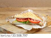Купить «Sandwich with tomatoes, cheese and ham on a dark, wooden background», фото № 33508797, снято 8 апреля 2020 г. (c) Марина Володько / Фотобанк Лори