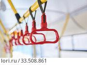 Купить «Grab handles in the passenger compartment of the bus on a blurred background», фото № 33508861, снято 31 марта 2020 г. (c) Евгений Харитонов / Фотобанк Лори