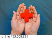 Red cross on the palms of a young girl. Стоковое фото, фотограф Федонников Никита Александрович / Фотобанк Лори