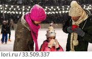 happy family drinking hot tea on skating rink. Стоковое видео, видеограф Syda Productions / Фотобанк Лори