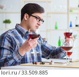 Купить «Professional sommelier tasting red wine», фото № 33509885, снято 31 марта 2017 г. (c) Elnur / Фотобанк Лори