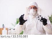 Купить «Doctor working in lab in coronavirus COVID-19 concept», фото № 33510081, снято 16 марта 2020 г. (c) Elnur / Фотобанк Лори