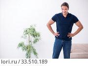 Купить «Young male contractor installing furniture at home», фото № 33510189, снято 11 ноября 2019 г. (c) Elnur / Фотобанк Лори