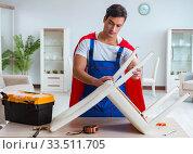 Купить «Super hero repairman working at home», фото № 33511705, снято 23 декабря 2016 г. (c) Elnur / Фотобанк Лори