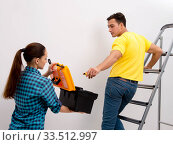Wife and husband family doing home improvements. Стоковое фото, фотограф Elnur / Фотобанк Лори