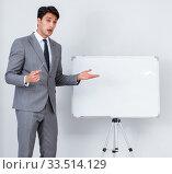 Купить «Business presentation in the office with man and woman», фото № 33514129, снято 7 августа 2017 г. (c) Elnur / Фотобанк Лори