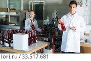 man and woman working on wine production. Стоковое фото, фотограф Яков Филимонов / Фотобанк Лори
