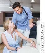 Купить «married couple are choosing new sofa», фото № 33517721, снято 19 июня 2017 г. (c) Яков Филимонов / Фотобанк Лори