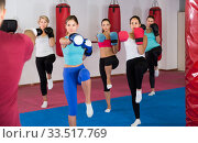 group of women different ages and their trainer are boxing in gym. Стоковое фото, фотограф Яков Филимонов / Фотобанк Лори