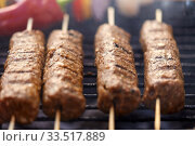 close up of barbecue kebab meat roasting on grill. Стоковое фото, фотограф Syda Productions / Фотобанк Лори