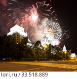 Купить «Moscow University (main building) and fireworks in honor of Victory Day celebration (WWII), Russia», фото № 33518889, снято 9 мая 2019 г. (c) Владимир Журавлев / Фотобанк Лори