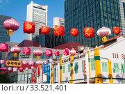 Купить «Singapore, Republic of Singapore, Colorful street scene with lanterns in Chinatown», фото № 33521401, снято 24 января 2020 г. (c) Caro Photoagency / Фотобанк Лори