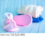 Купить «Baby clothes on a table, clothes for little baby girl», фото № 33523405, снято 8 июля 2020 г. (c) age Fotostock / Фотобанк Лори