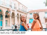 Купить «Tourist girl in popular area in Havana, Cuba.», фото № 33526809, снято 13 апреля 2017 г. (c) Дмитрий Травников / Фотобанк Лори