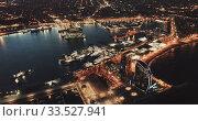Купить «View from drone of illuminated Barceloneta beach with Port Vell t night», видеоролик № 33527941, снято 26 марта 2019 г. (c) Яков Филимонов / Фотобанк Лори
