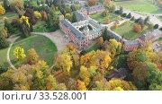 Fall view from drone of medieval Sychrov Castle, Czech Republic. Стоковое видео, видеограф Яков Филимонов / Фотобанк Лори