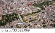 Купить «Aerial view of ancient Templar castle in small Spanish city of Ponferrada on background of modern cityscape», видеоролик № 33528069, снято 19 июня 2019 г. (c) Яков Филимонов / Фотобанк Лори