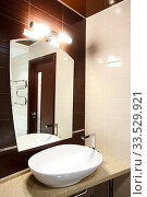 Купить «The beautiful modern bathroom finished with a tile», фото № 33529921, снято 15 июля 2020 г. (c) age Fotostock / Фотобанк Лори