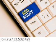 Conceptual hand writing showing Seo Audit. Concept meaning Search Engine Optimization validating and verifying process White pc keyboard with note paper above the white background. Стоковое фото, фотограф Zoonar.com/Artur Szczybylo / easy Fotostock / Фотобанк Лори