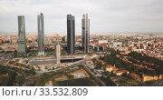 Купить «Four business skyscrapers (Cuatro Torres) of the business district in Madrid. Spain», видеоролик № 33532809, снято 16 июня 2019 г. (c) Яков Филимонов / Фотобанк Лори