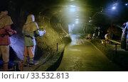 Long tunnel of medieval Wieliczka salt mine with sculptures illustrating daily work of ancient miners. Редакционное видео, видеограф Яков Филимонов / Фотобанк Лори