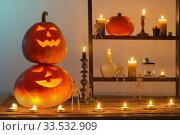 Купить «halloween pumpkins with candles on wooden table», фото № 33532909, снято 1 ноября 2019 г. (c) Майя Крученкова / Фотобанк Лори