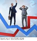 Купить «Businessman with charts of growth and decline», фото № 33535029, снято 20 апреля 2020 г. (c) Elnur / Фотобанк Лори