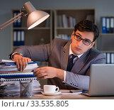 Купить «Businessman staying in the office for long hours», фото № 33535805, снято 18 октября 2016 г. (c) Elnur / Фотобанк Лори