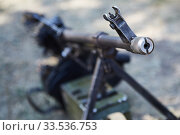 Russian machine gun stands on the ground. Focus on the gun barrel. Стоковое фото, фотограф Олег Белов / Фотобанк Лори