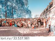 "Russia, Samara, June 2019. Spectators at a lecture on the open area of the beach. Bank of the Volga. Festival ""Volga Fest"" Редакционное фото, фотограф Акиньшин Владимир / Фотобанк Лори"