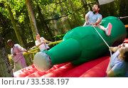Купить «Funny attraction with a huge inflatable bottle in an amusement park», фото № 33538197, снято 29 мая 2019 г. (c) Яков Филимонов / Фотобанк Лори
