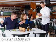 Couple dissatisfied with service of restaurant. Стоковое фото, фотограф Яков Филимонов / Фотобанк Лори
