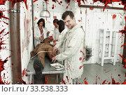 Guy with mad look over zombie mannequin. Стоковое фото, фотограф Яков Филимонов / Фотобанк Лори