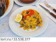 Appetizing seafood dish Paella with shrimp. Spanish cuisine. Стоковое фото, фотограф Яков Филимонов / Фотобанк Лори
