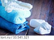 Купить «Baby clothes for boy on the wooden table», фото № 33541321, снято 8 июля 2020 г. (c) age Fotostock / Фотобанк Лори