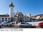 Купить «Building and tower of the Basilica of the Royal Marian Shrine of Our Lady of Candelaria. View from square the Plaza de la Patrona de Canarias. Тенерифе, Канары, Испания», фото № 33555949, снято 3 января 2016 г. (c) Кекяляйнен Андрей / Фотобанк Лори