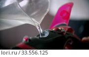 Filling an iron with water for steam ironing. Стоковое видео, видеограф Константин Шишкин / Фотобанк Лори