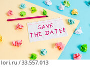 Text sign showing Save The Date. Business photo text reserve the mentioned future wedding date on their calendar Colored crumpled papers empty reminder blue yellow background clothespin. Стоковое фото, фотограф Zoonar.com/Artur Szczybylo / easy Fotostock / Фотобанк Лори