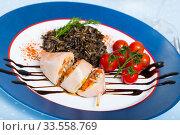 Купить «Stuffed squid with wild rice and cherry tomato is tasty dish», фото № 33558769, снято 5 августа 2020 г. (c) Яков Филимонов / Фотобанк Лори